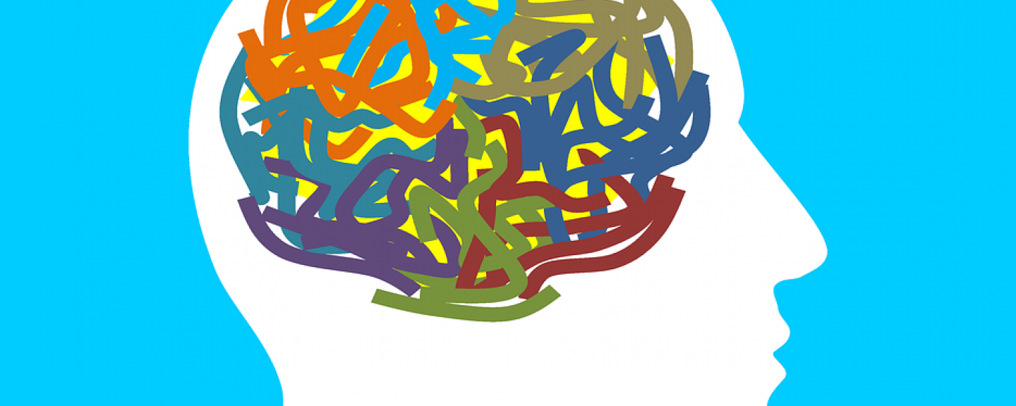 Drawing, Outline of Head, Multicoloured Wriggly Lines to represent mind, blue background