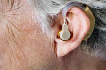 close up of hearing aid in an older person's ear