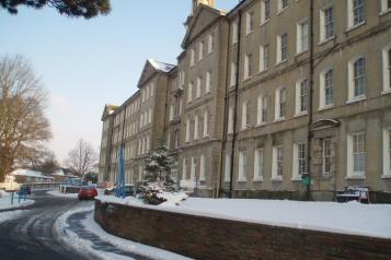 Front view of Brighton General, Snow Covers foreground and building