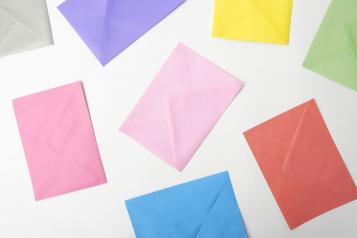 Photo, White backdrop, different coloured envelopes spread around