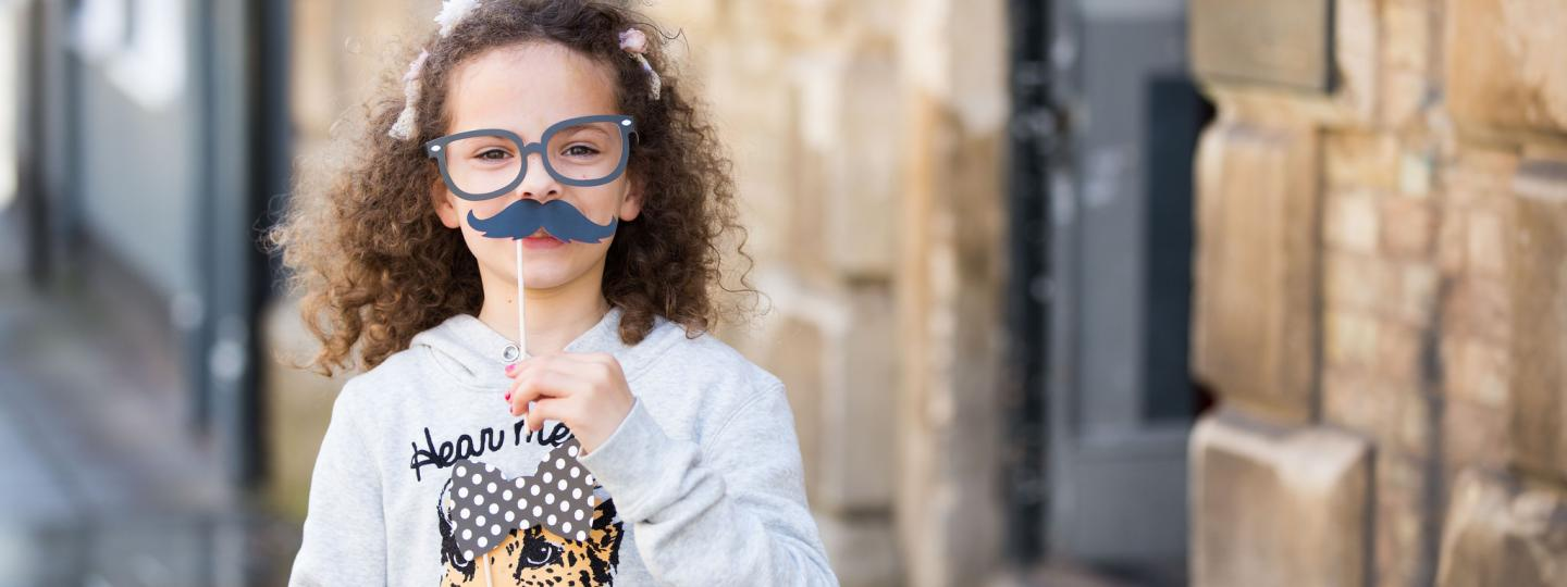 Child with a mustache prop