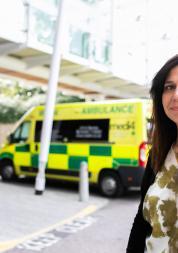 Lady next to ambulance